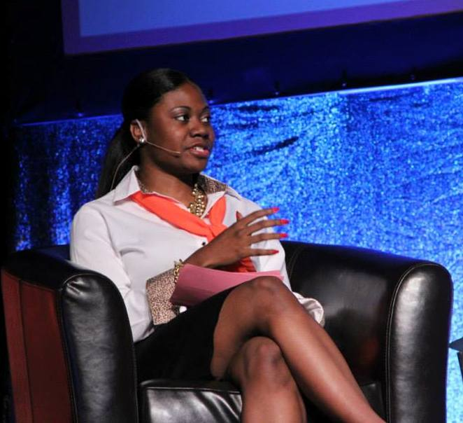 Photo of Sierra Austin, WGSS PhD student, speaks at YWCA's Annual Woman to Woman Luncheon.